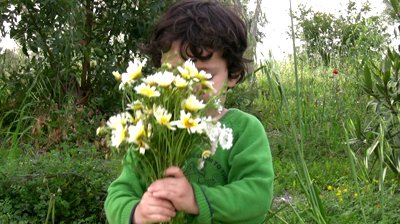 happy-little-boy-picking-the-flowers